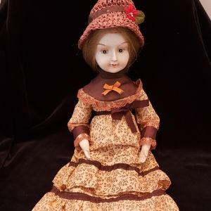 Vintage Porcelain Doll with Brown Dress and Hat